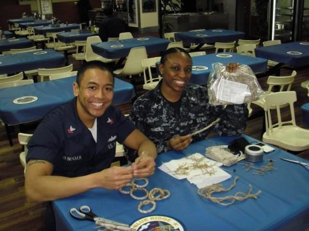 nick mendoza and volunteer making bracelets