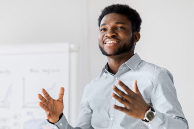Black man giving a business pitch