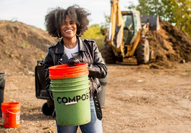 Woman carrying a compost bucket